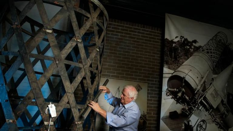 Campbell Johns, one of the volunteers at the Museum Victoria storeroom in Coburg, works on the restoration of the Great Melbourne Telescope.