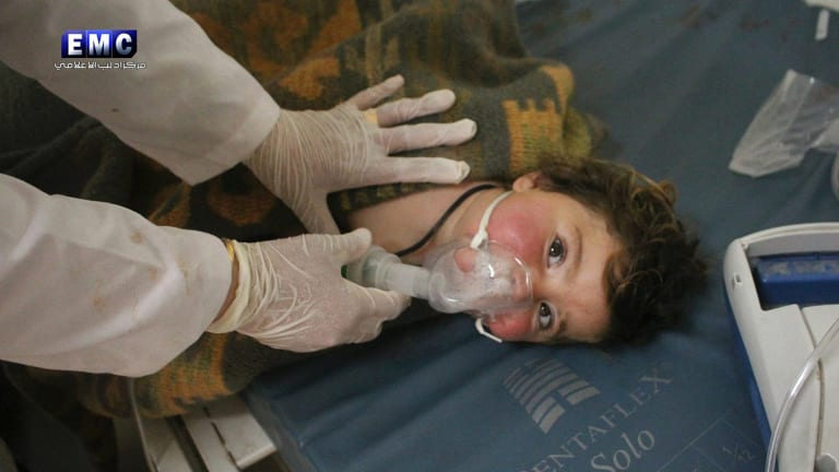 A child victim of the chemical attack is treated at a makeshift hospital.