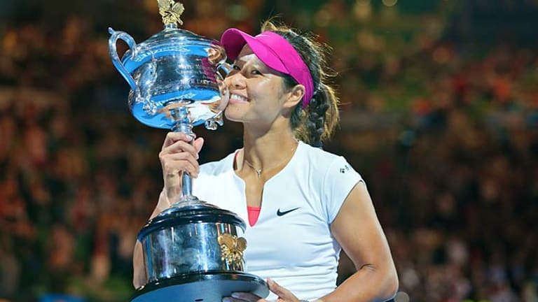 Li Na kisses her trophy after defeating Dominika Cibulkova in straight sets in the final.