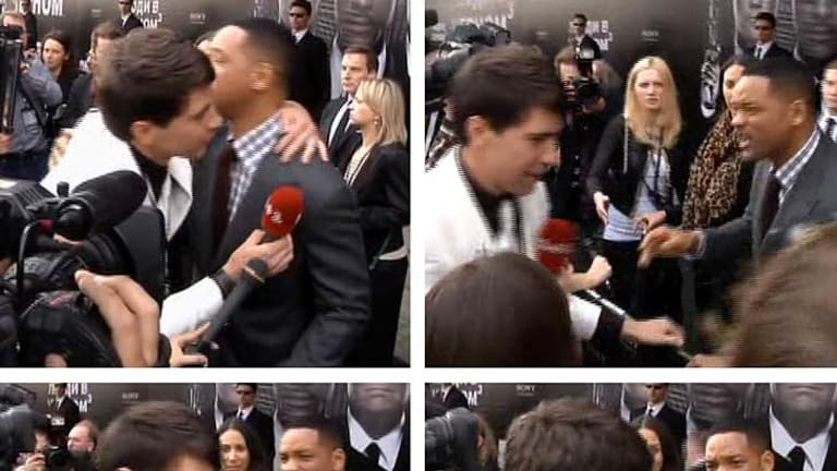 Will Smith slaps a Ukrainian television reporter who tried kissing the US actor.