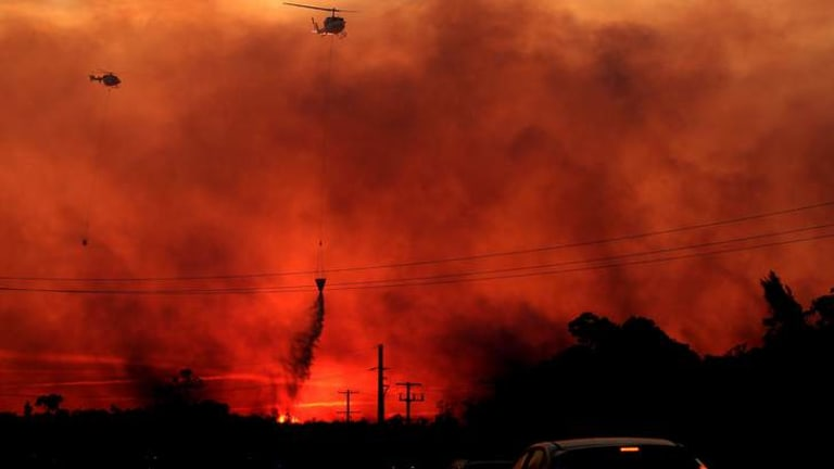 Helicopters drop water on a fire at Doyalson, NSW.