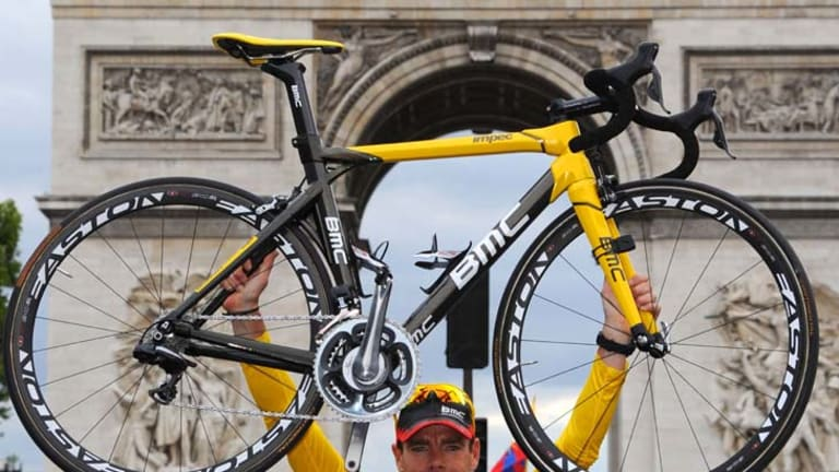 Raising expectations  ...  Cadel Evans celebrates his Tour de France victory in front of the Arc de Triomphe.