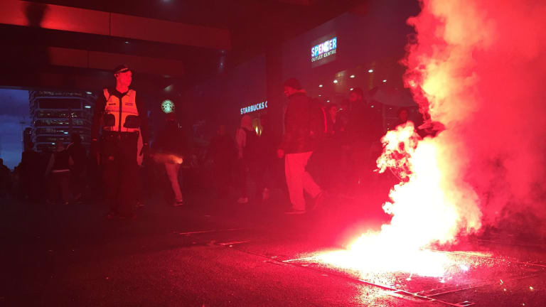 Flares are let off in the proximity of Southern Cross Station prior to the A-League finals Melbourne derby.