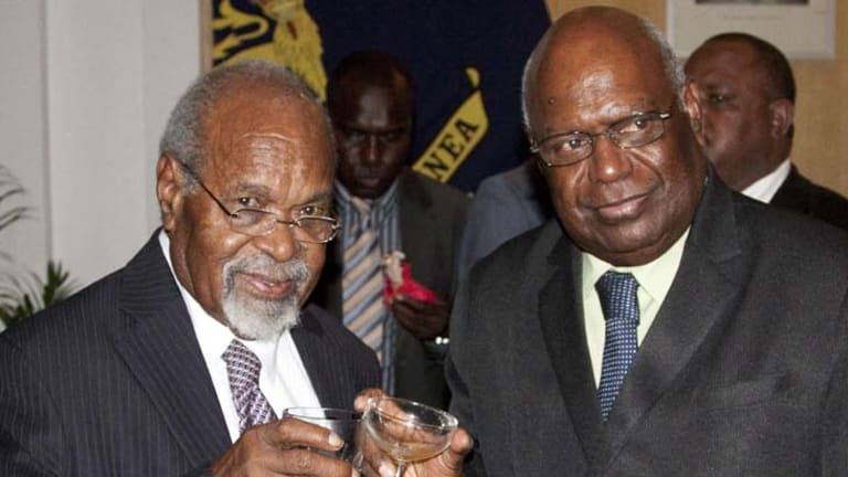 Australians warned as PNG soldiers mutiny in support of Sir Michael Somare,  left.