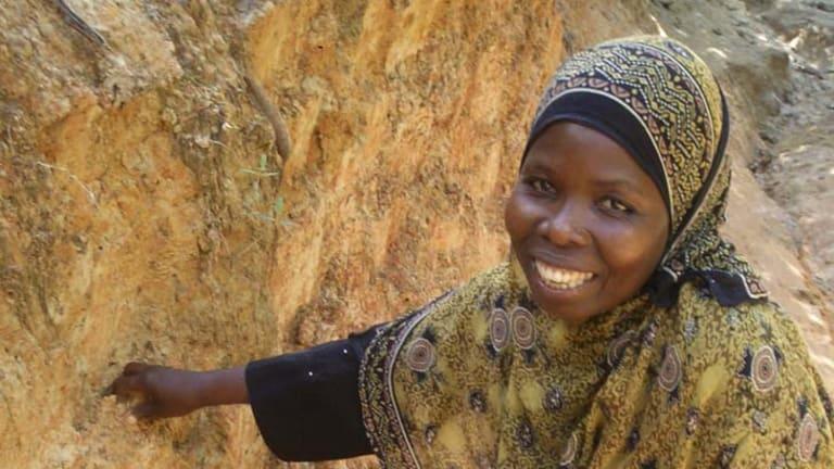 Digging in … A woman collects ''edible'' earth on Pemba Island, Zanzibar, Tanzania.