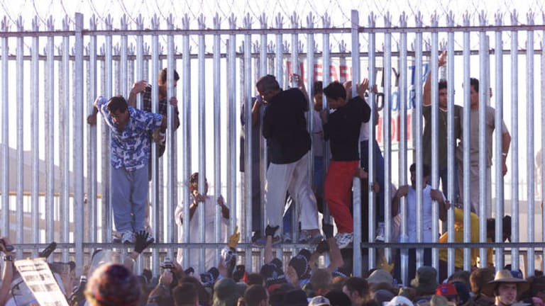 Detainees  breaking out of the Woomera detention centre during a protest where demonstrators broke though the outer perimiter fence of the centre and went up to the main fence.