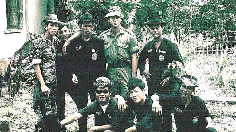 Historian Derrill de Heer in Vietnam with South Vietnamese soldiers in Hoi My village in 1970.