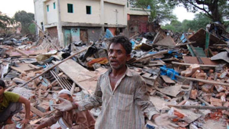 Homeless and angry: Slum resident Basant Paswan  beside the ruins of  his house in Delhi's Netaji Nagar slum.