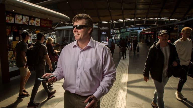 Visually-impaired David Meere at Southern Cross Station. Mr Meere says the technology will make people with a disability more independent.