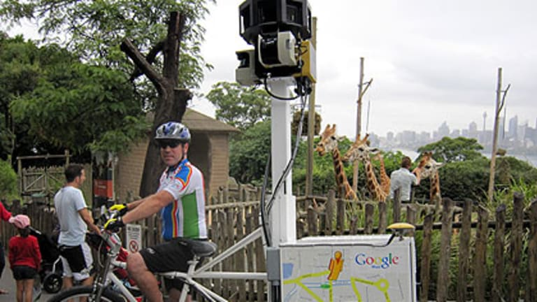 The giraffes at Taronga zoo watch a Google tricycle mapping the parts the cars can't reach.