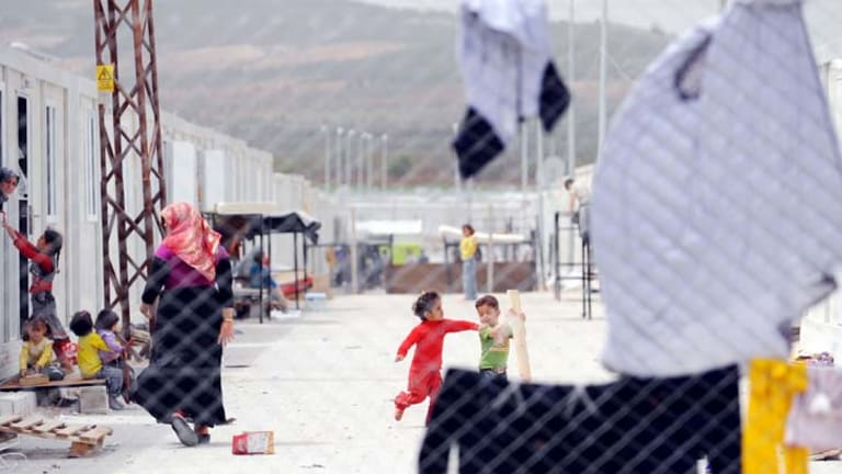 Syrian refugees at the Oncupinar refugee camp in Kilis near the Syrian border ... there are reports that Syria's army opened fire in some parts of the country in violation of the ceasefire.