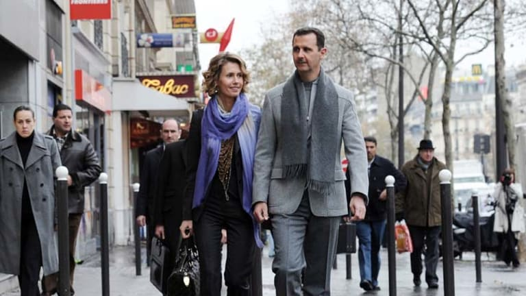 Cocooned in a life of luxury and denial … Bashar al-Assad and Asma in Paris in 2010. At the height of the crackdown she spent thousands of dollars on internet shopping.