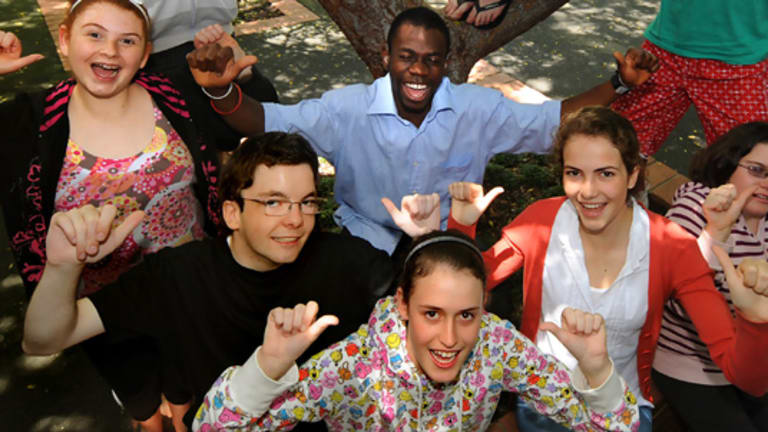 Year 12 students at the Victorian College for the Deaf sign success after top VCE results.