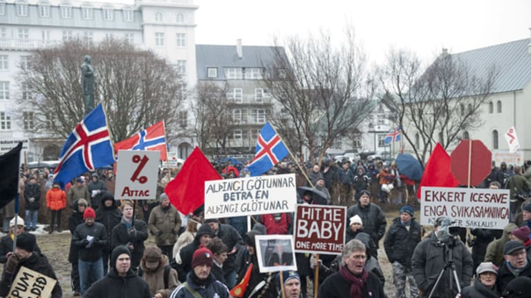 Taking to the streets ... protesters outside the Icelandic parliament in Reykjavik .
