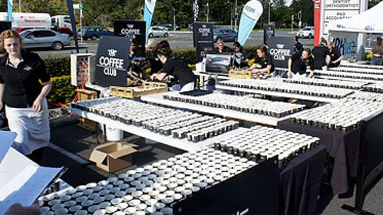 Twenty Brisbane baristas have broken the world record for the most espressos made in one hour.