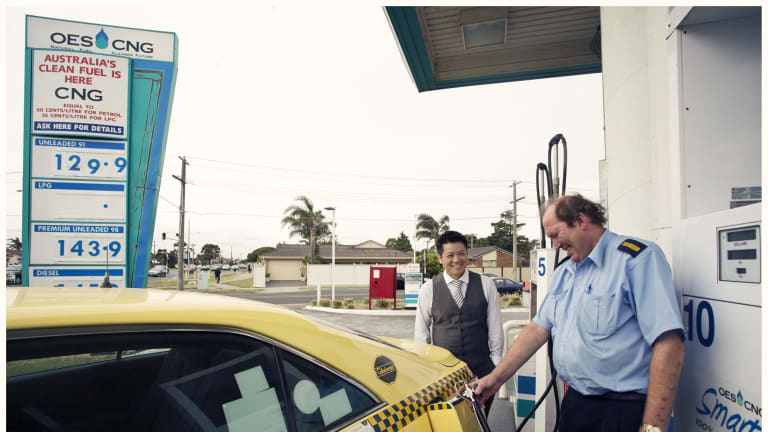 Good value: Tuyen Hua, left, of OES CNG SmartGas, watches as Eastmorr Taxis driver Robert Howard fuels up.