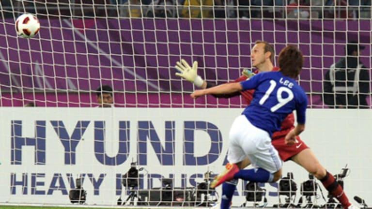 Japan striker Tadanari Lee beats Australian goalkeeper Mark Schwarzer to score the winning goal in the 2011 Asian Cup final.