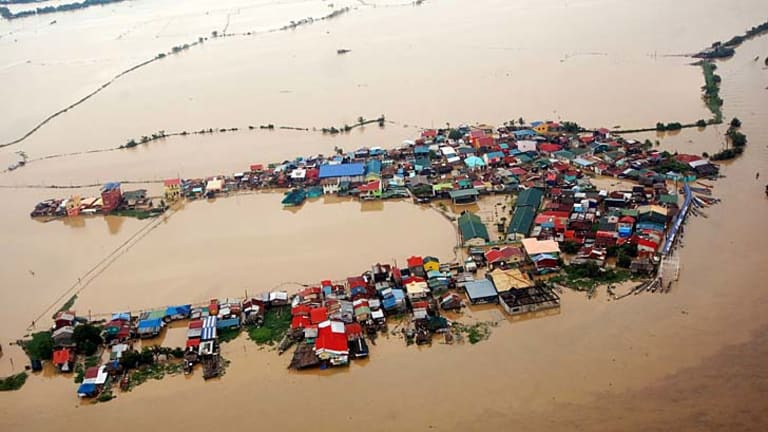 Houses swamped by floodwaters in Bulacan province, north of Manila
