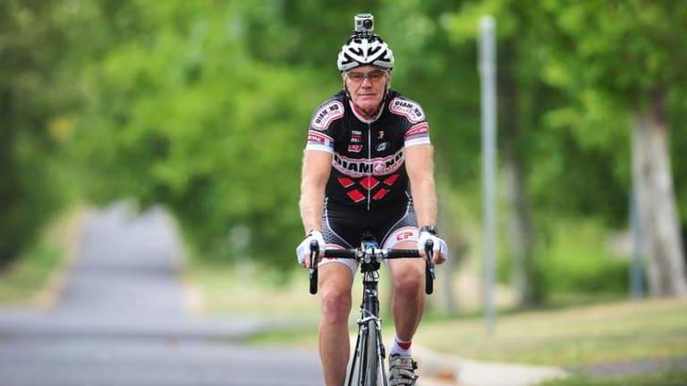 Rob Diamond, president of the ACT Vets cycling club, uses a bike camera.