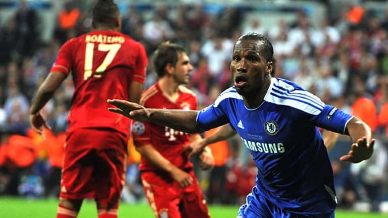 All square ... Didier Drogba celebrates as he equalises for Chelsea with two minutes of normal time to go.