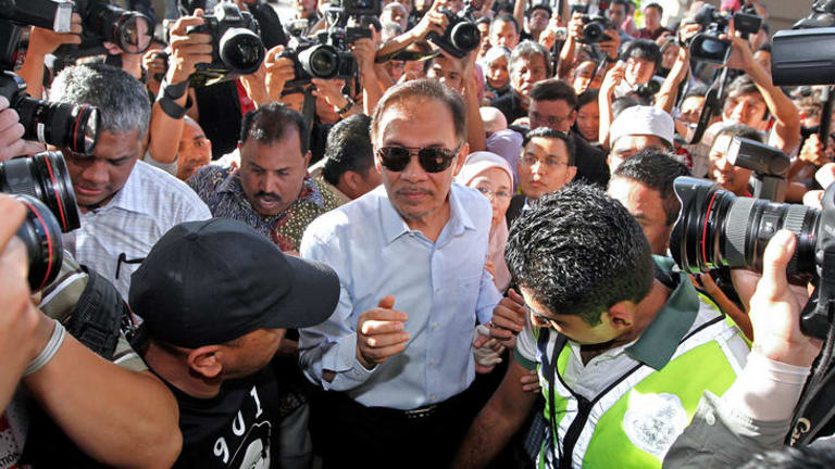 Malaysian Opposition Leader Anwar Ibrahim is mobbed by supporters and the media after his surprise acquittal yesterday on sodomy charges.