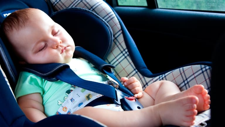 A baby left in a locked car on a hot day is at risk of death in 10 minutes. (file pic)