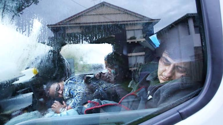 No access: Members of the family sleeping in a rental truck.
