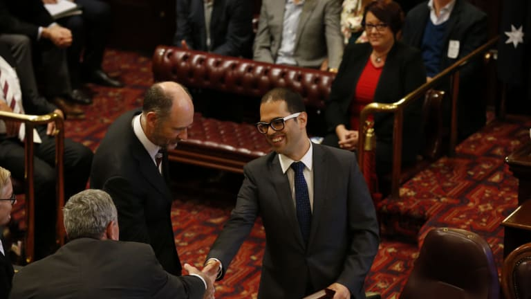 Newly appointed Upper House MP Daniel Mookhey shakes hands with Liberal MP Duncan Gay.