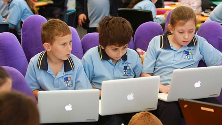 Noisier but not distracting . . . Zac Gerheard (from left), Christian Stathopoulos and Bessie Phillips work on their laptops in the mega classroom at St Monica's Primary.