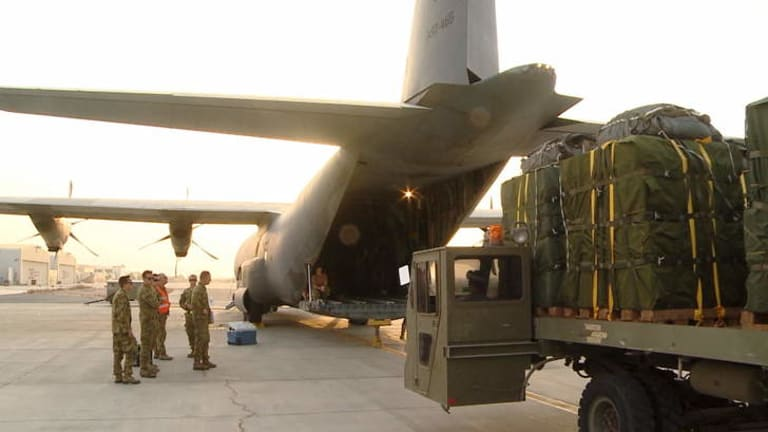 Australian Army personnel prepare a Hercules to drop supplies to isolated Iraqi civilians on Mount Sinjar in northern Iraq.