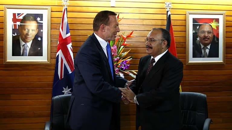 """""""It's a joint effort"""": Prime Minister Tony Abbott and PNG Prime Minister Peter O'Neill in Port Moresby."""