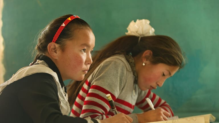 Aisholpan (left) at school, in The Eagle Huntress.