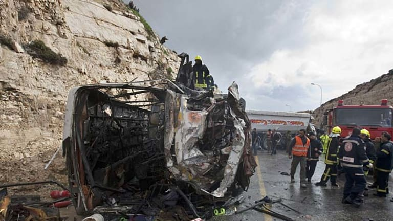Tragedy ... Israeli firefighters gather at the site of the crash.