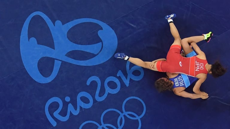 Valeria Koblova Zholobova of Russia (blue) competes against Kaori Icho of Japan during the Women's Freestyle 58 kg Gold Medal match.
