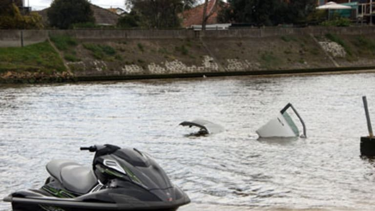 One floats, one doesn't ... Jet-ski beats car when it comes to handling in the wet.