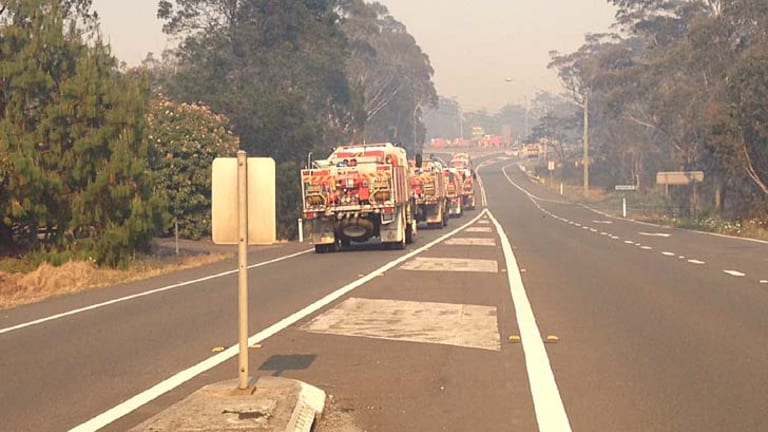 Fire trucks head towards Lithgow on Monday morning.