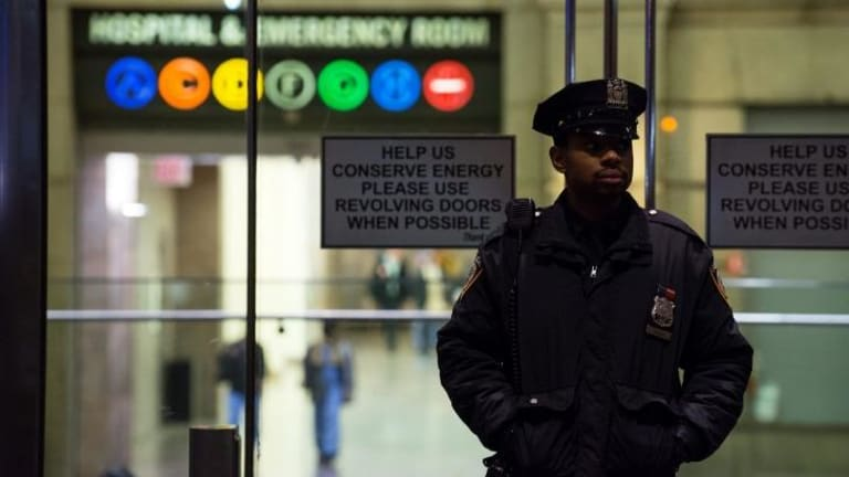 On guard: A policeman stands at the entrance to New York's Bellevue Hospital after the city's first case of Ebola was confirmed.