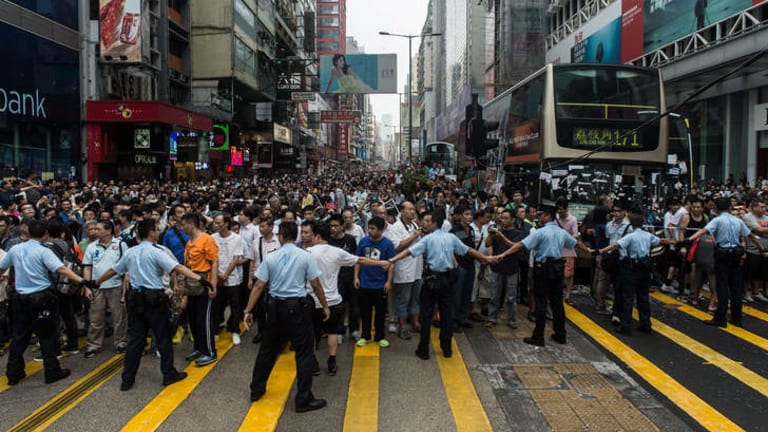 Police form a line to prevent onlookers from entering an area being used by pro-democracy protestors in Kowloon.