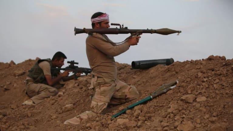 Peshmerga fighters guard a position against Islamic State (IS) militants 20 kilometres east of Mosul.