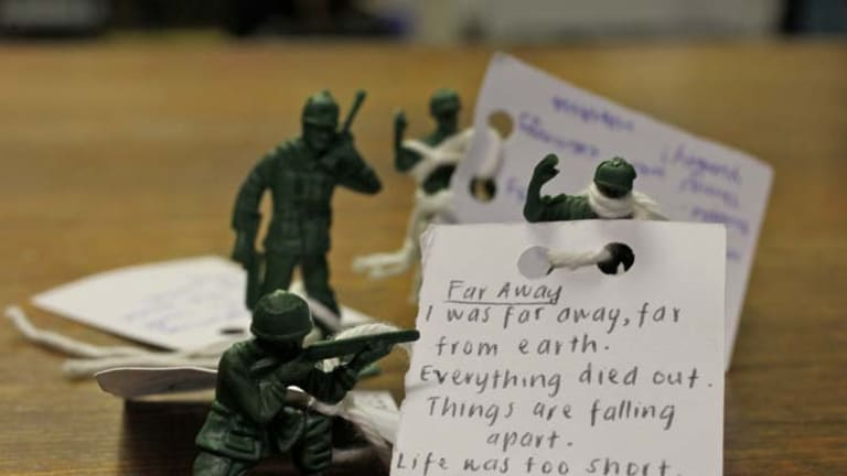 Fighting words ... poetry written by Marrickville students is attached to toy soldiers.