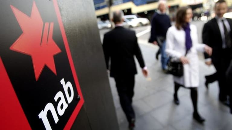 NAB projects a 14 per cent fall in full-year cash profit in the range of $5.1 billion to $5.2 billion, compared with year-earlier profit of $5.94 billion, and a Bloomberg consensus estimate of $6.18 billion.