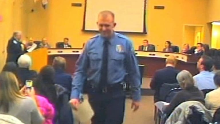 Police officer Darren Wilson attends a city council meeting in Ferguson, Missouri on February 11.