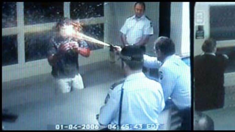 John Arthur Birch, left,  and Joanne Theta Apostoloff, right, captured on CCTV footage using capsicum foam.