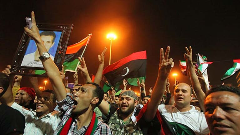 Overjoyed ... anti-government Libyans in Benghazi celebrate reports of the death of Muammar Gaddafi's youngest son.