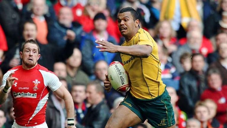 Man of the match Kurtley Beale heads for the tryline.