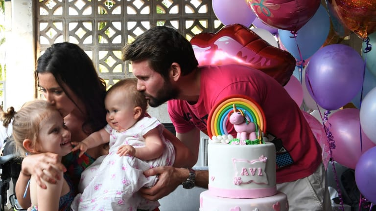 Bethan McElwee and her husband Johnny with Aviana and their niece at Aviana's first birthday party at their home in Darwin.