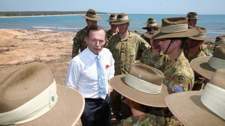Prime Minister Tony Abbott meets with soldiers in North East Arnhem Land on Thursday.