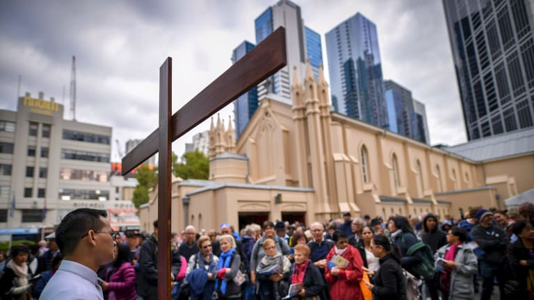 Some of the estimated 2000 people who attended the Stations of the Cross walk through Melbourne's CBD on Good Friday.