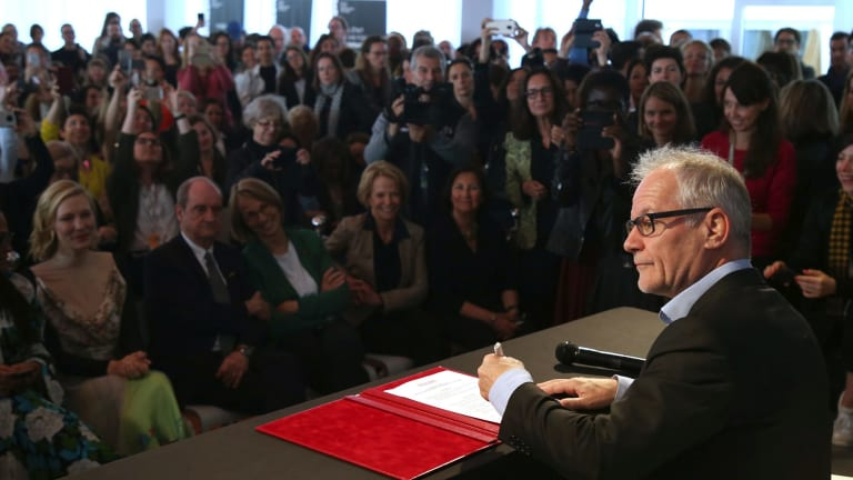 Fremaux signs the pledge.