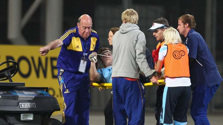 That hurts … Pat McCutcheon is stretchered from the field in Dunedin on Saturday night.
